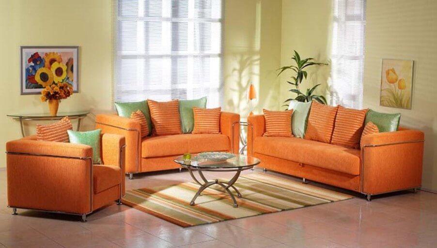 10 awesomely creative pouf ideas for interior design for Orange sofa living room ideas