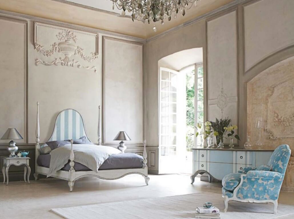 Luxurious-post-bed-large-bedroom-with-french-door-and-blue-armchair-and-luxurious-bed