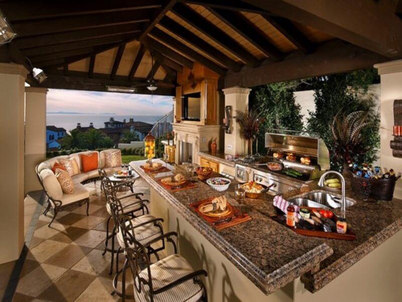 Mediterranean Outdoor Kitchen Wih Outdoor Dining Sets And Kitchenware