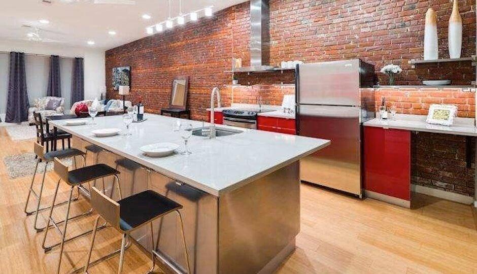 Spacious Kitchen with Brick Walls