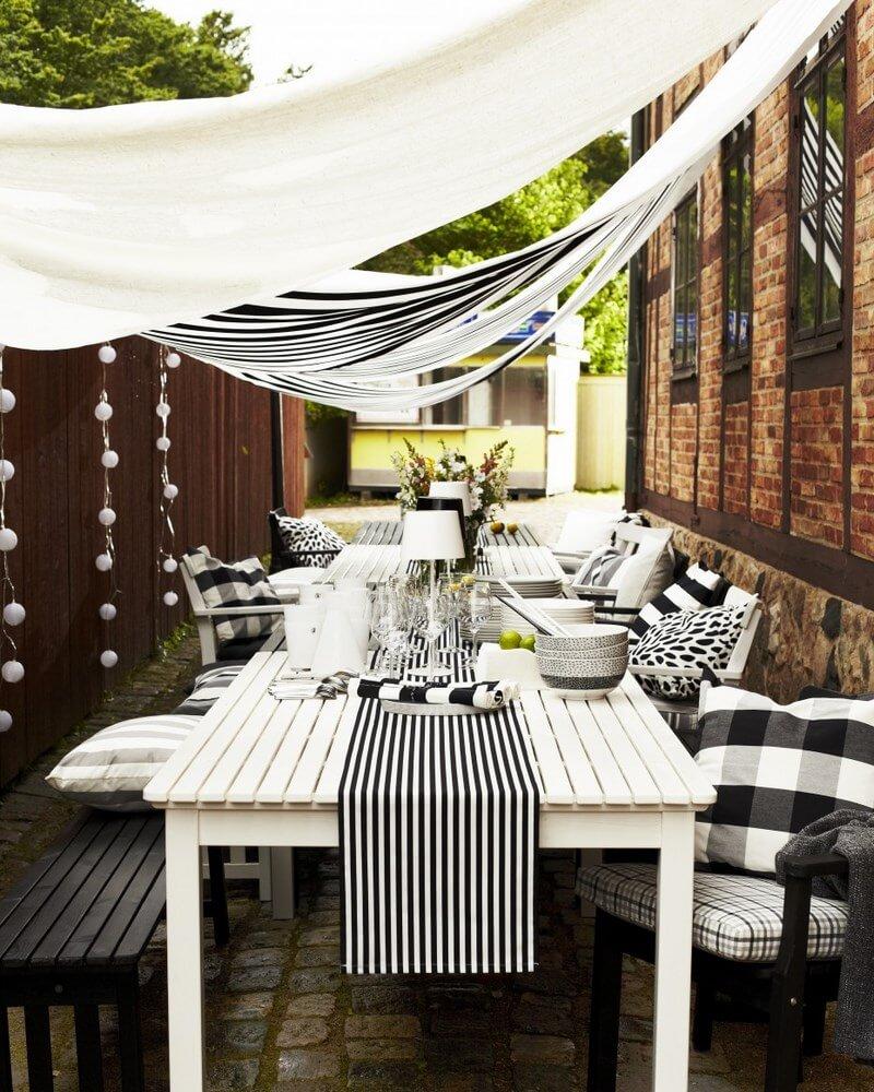 furniture-dining-room-magnificent-white-wooden-long-table-and-simplistic-chairs-with-black-and-white-cushions-ikea-dining-sets-as-well-as-natural-brick-exposed-wall-landscape-and-black-windows-