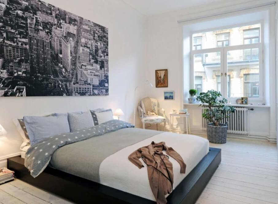 contemporary-bedroom-with-platform-bed-and-oversized-artwork-915x671