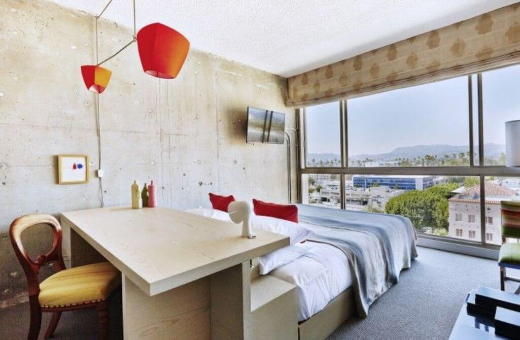 Airy Bedroom with Concrete Wall