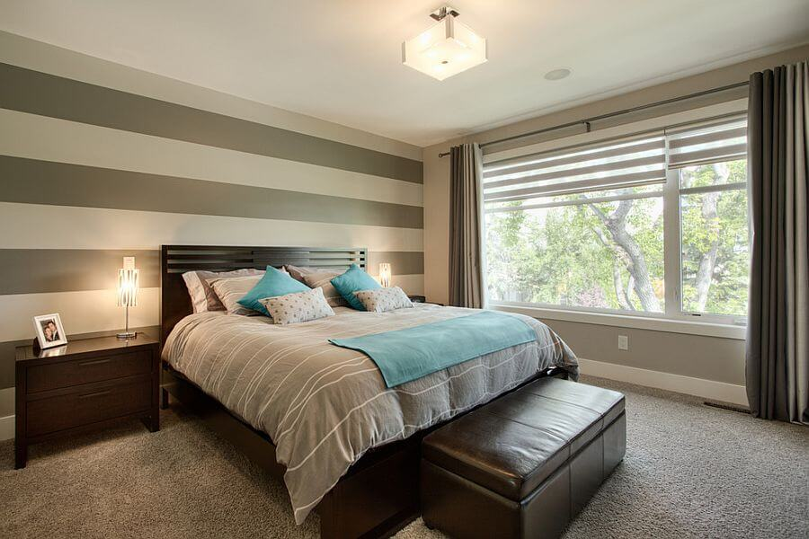 Cozy bedroom with striped walls