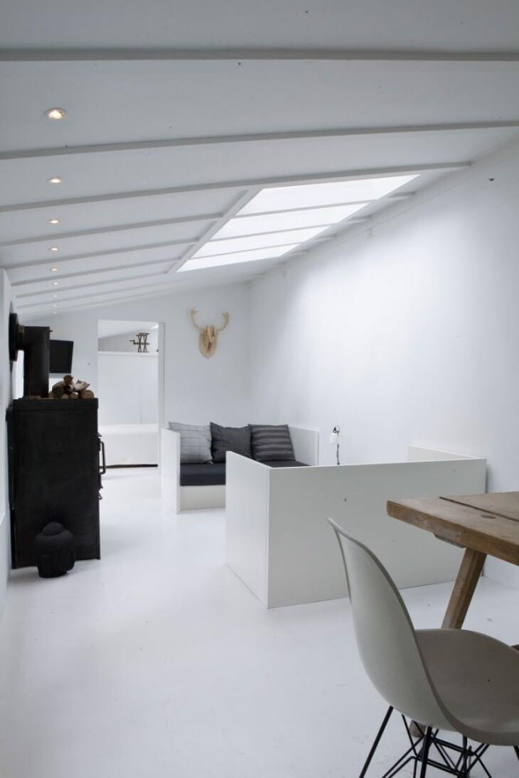 Sleek Living Room with skylight