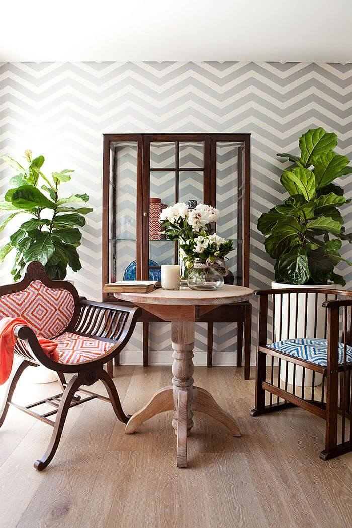 Wallpaper-brings-chevron-style-to-the-small-shabby-chic-dining-space