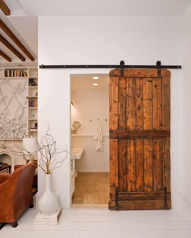 Beautiful White Bathroom with Rustic Sliding Barn Door