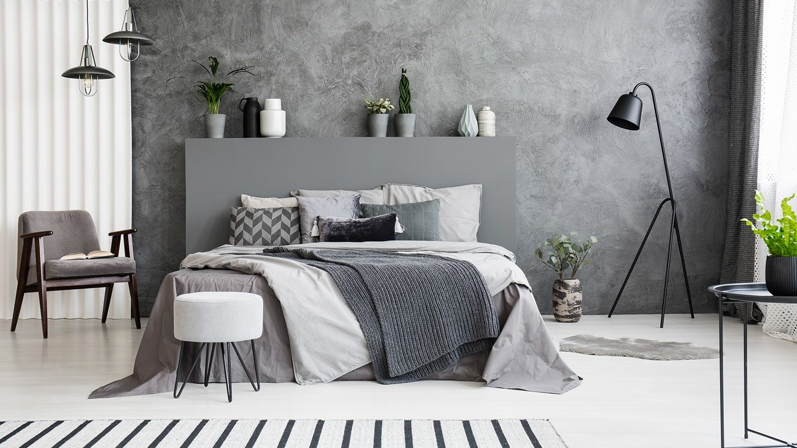 Grey bedroom with stool