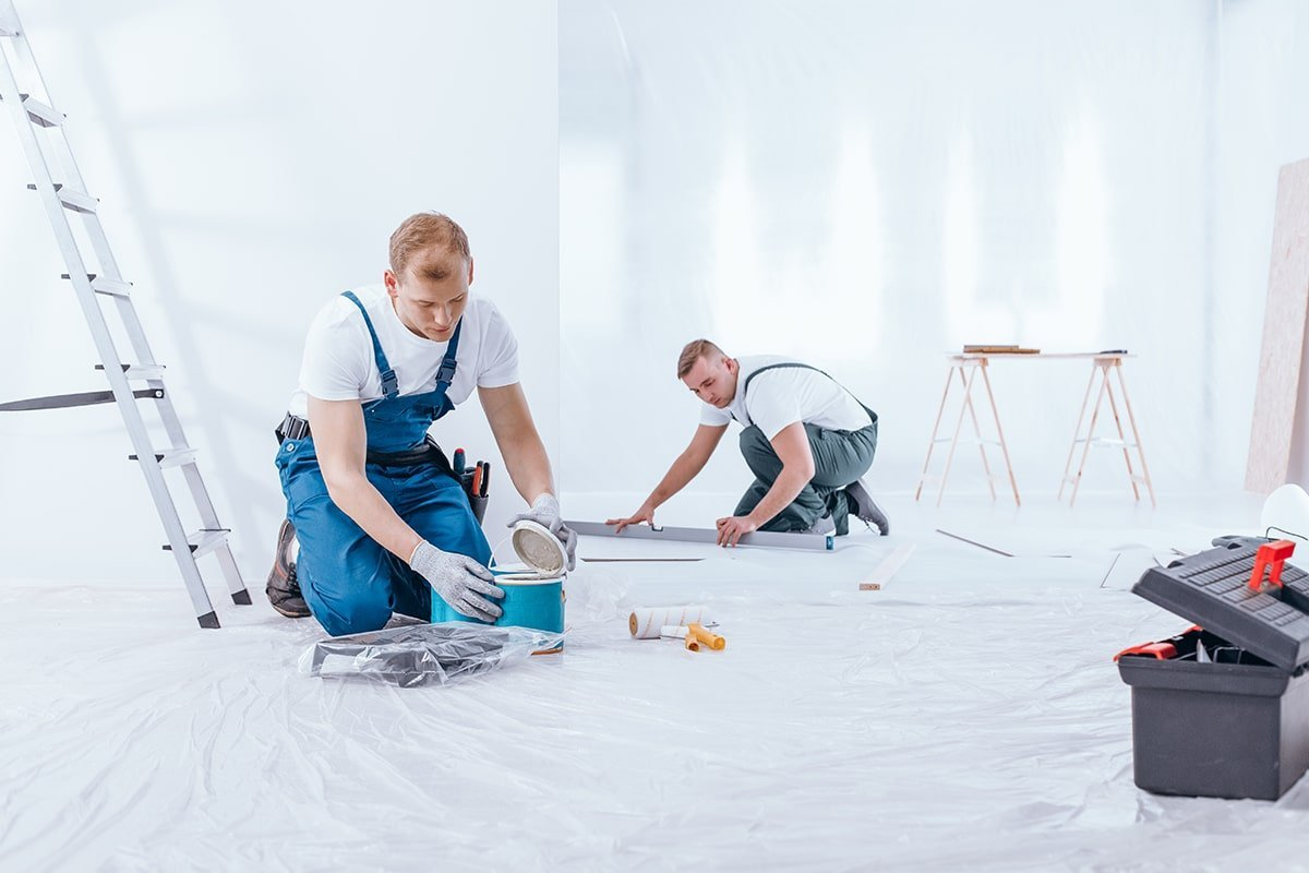 Painters painting large room