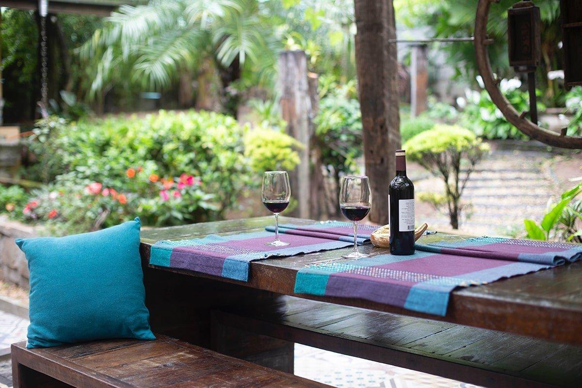 Wine bottles on backyard porch
