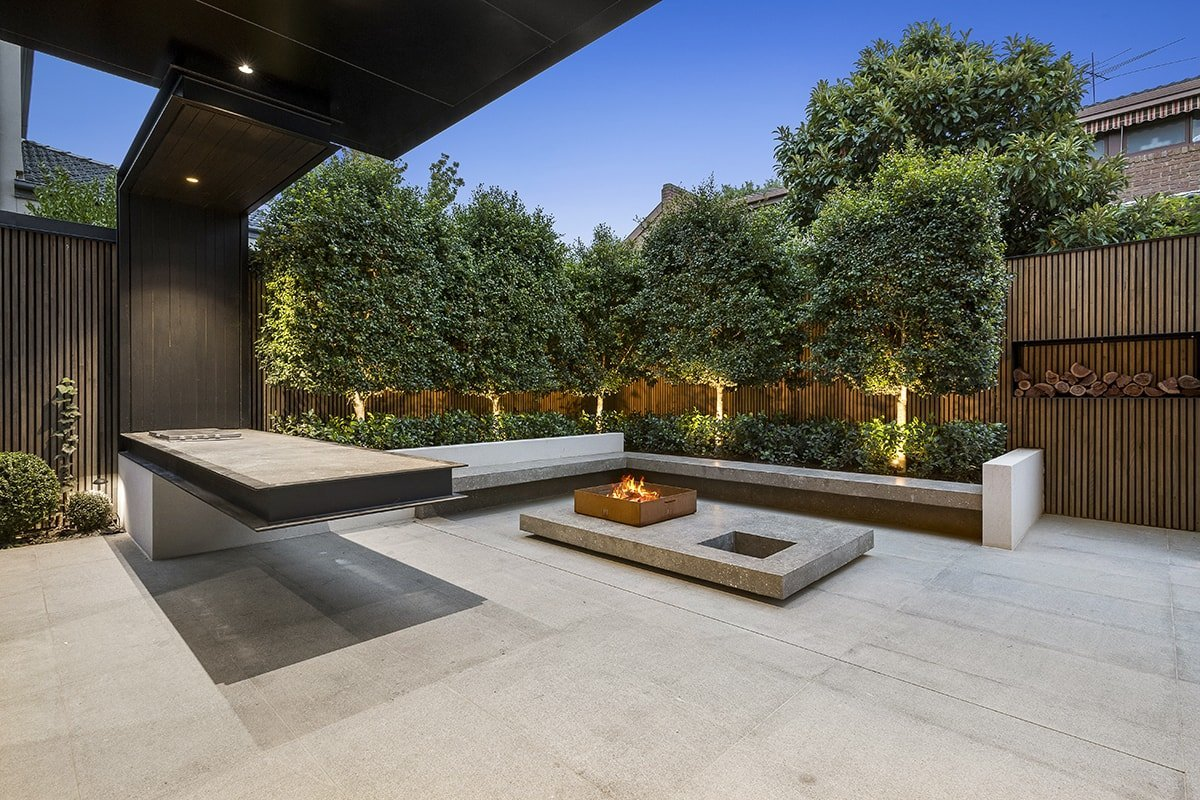 Backyard with fireplace and lighting