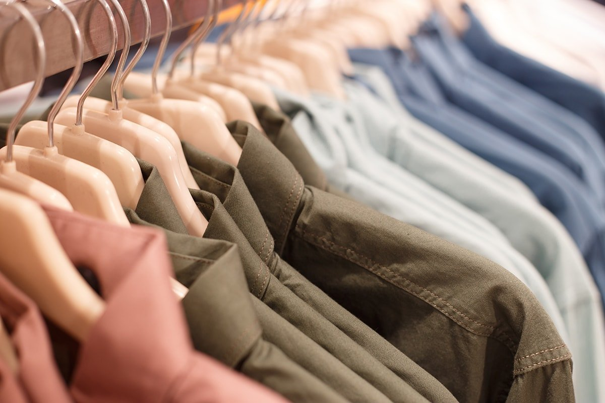 Clothes organized in closet by season