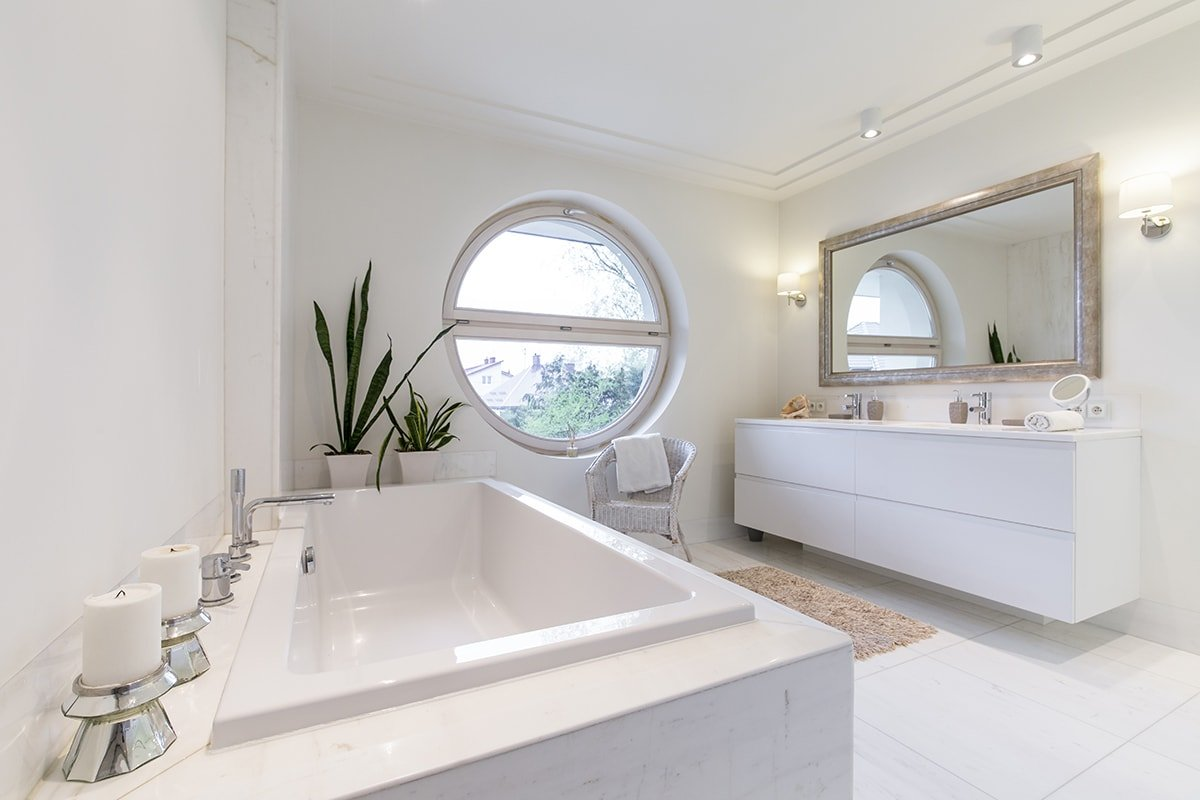 White bathroom with large mirror