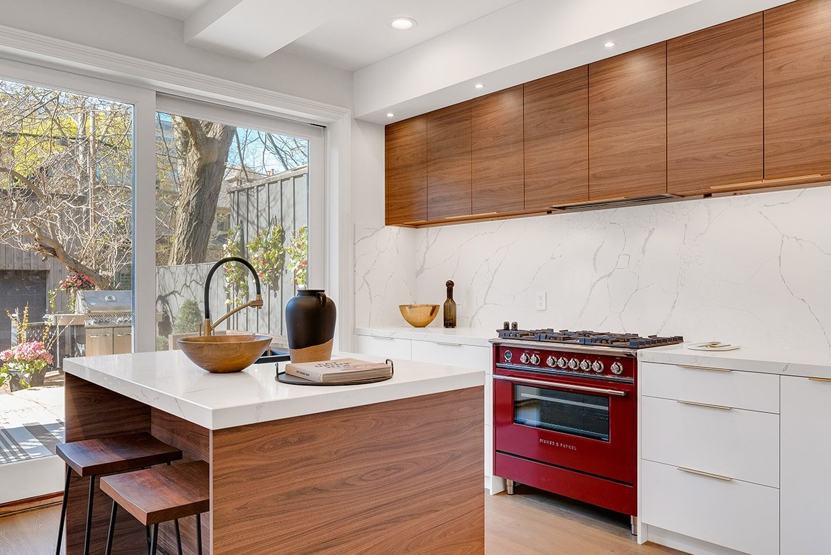 White kitchen with red stove