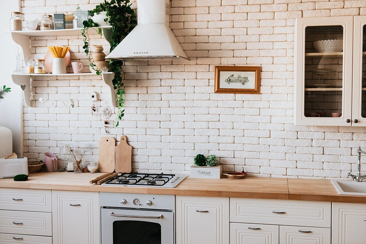 Kitchen with white brick wall