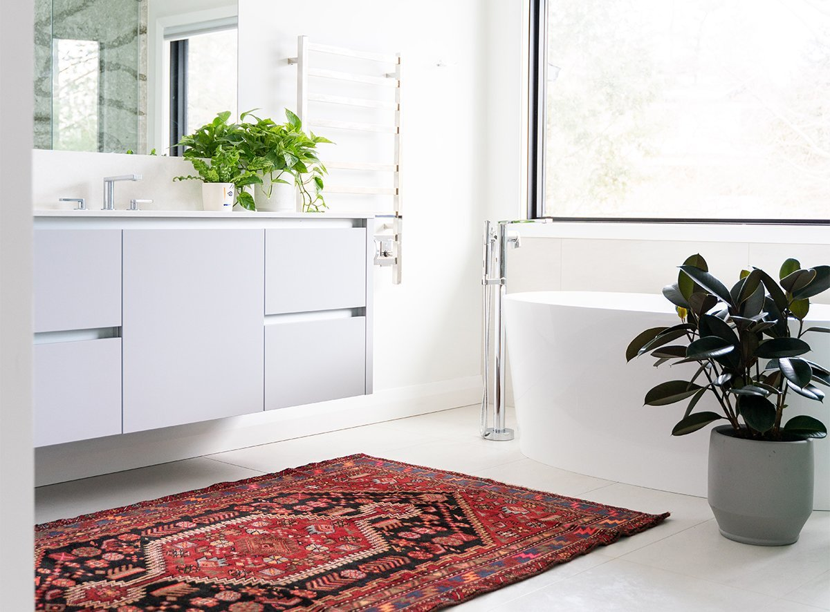White bathroom with red rug