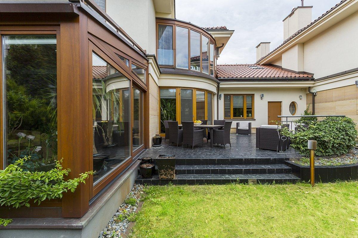 Elegant backyard with bow windows