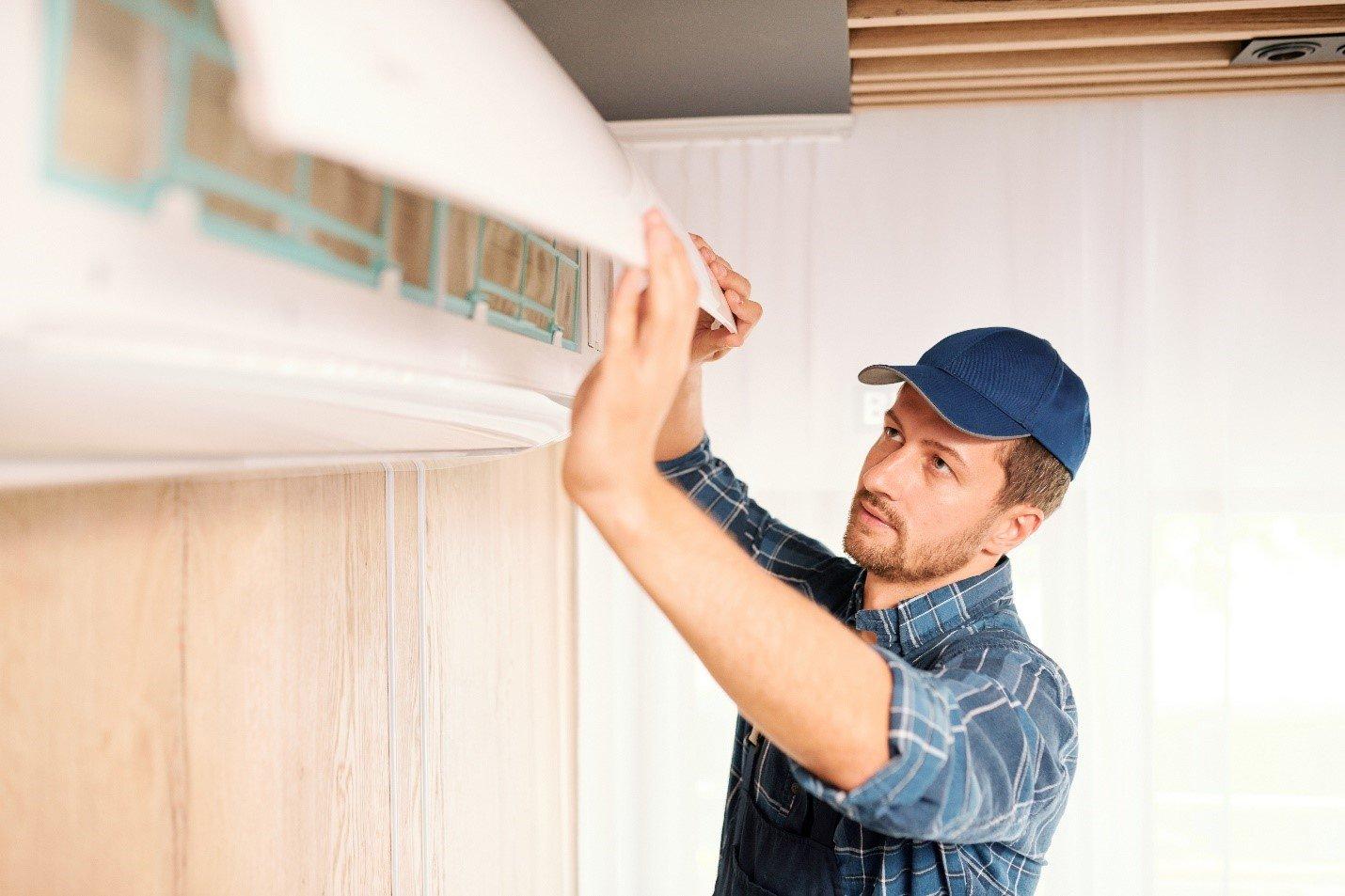 Man repairing an air conditioner