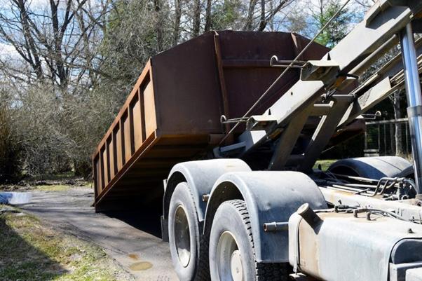 Dumpster on back of truck