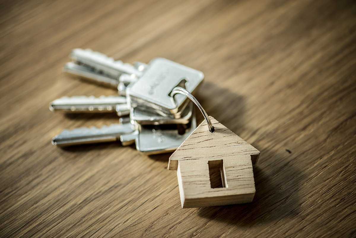 Keys with house keychain on table