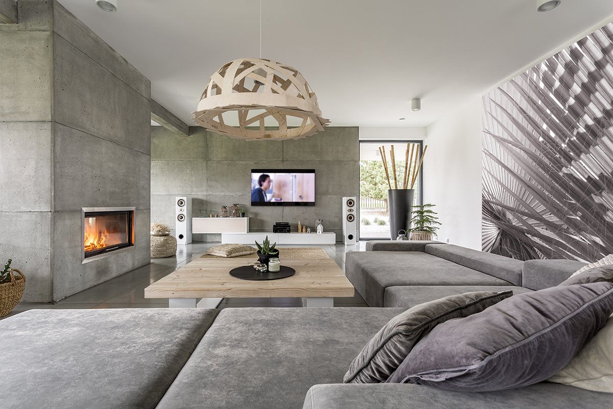 Concrete living room with fireplace and big sofa