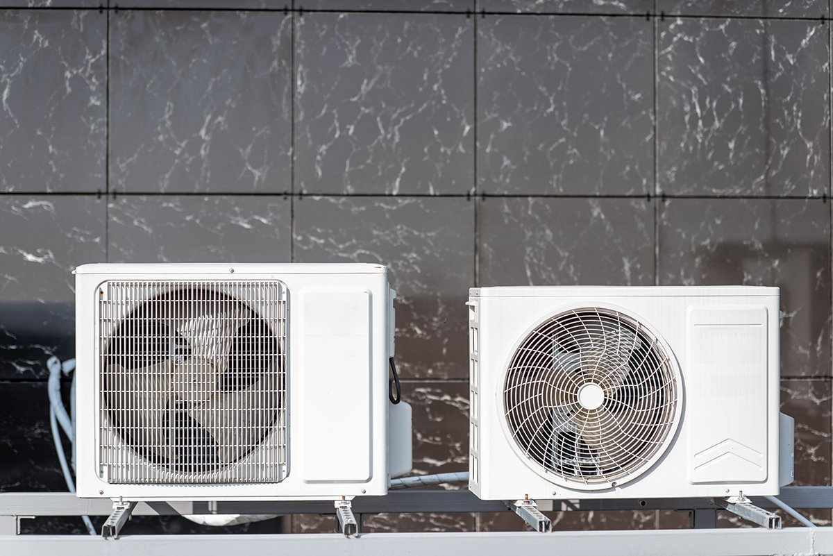 Outdoor units of the air conditioner or heat pump on the building facade
