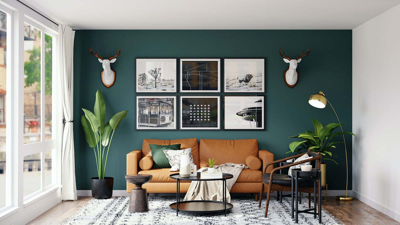 Deep green accent wall in living room