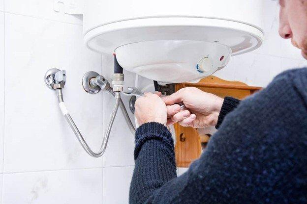 Plumber doing sink maintenance