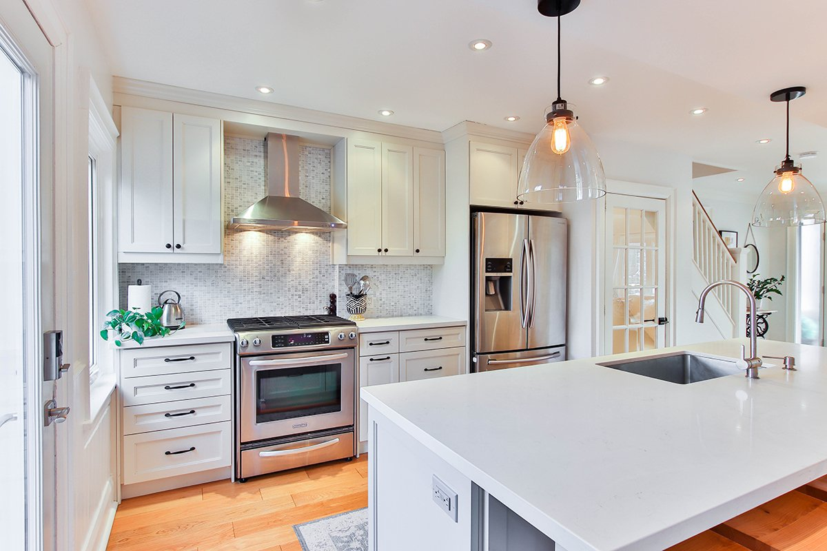 White themed kitchen with marble counter tops