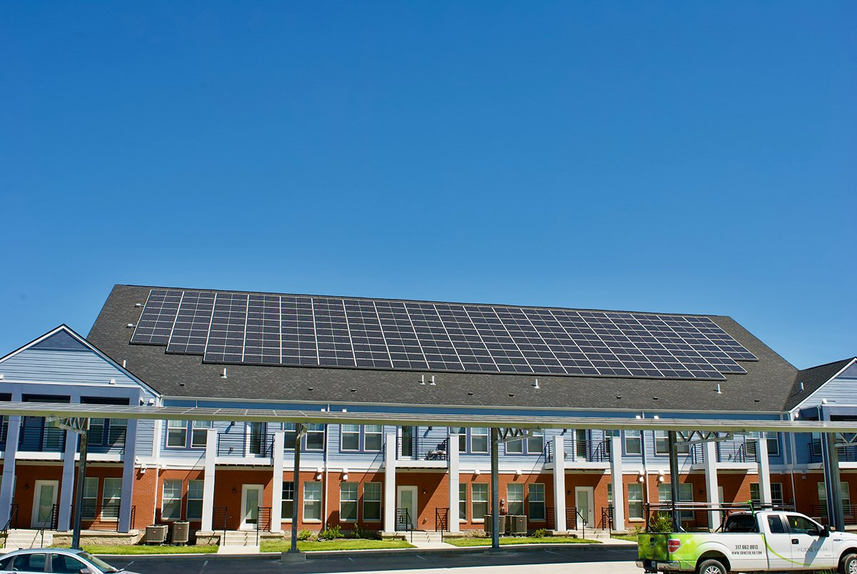 Apartment building with solar panels on roof