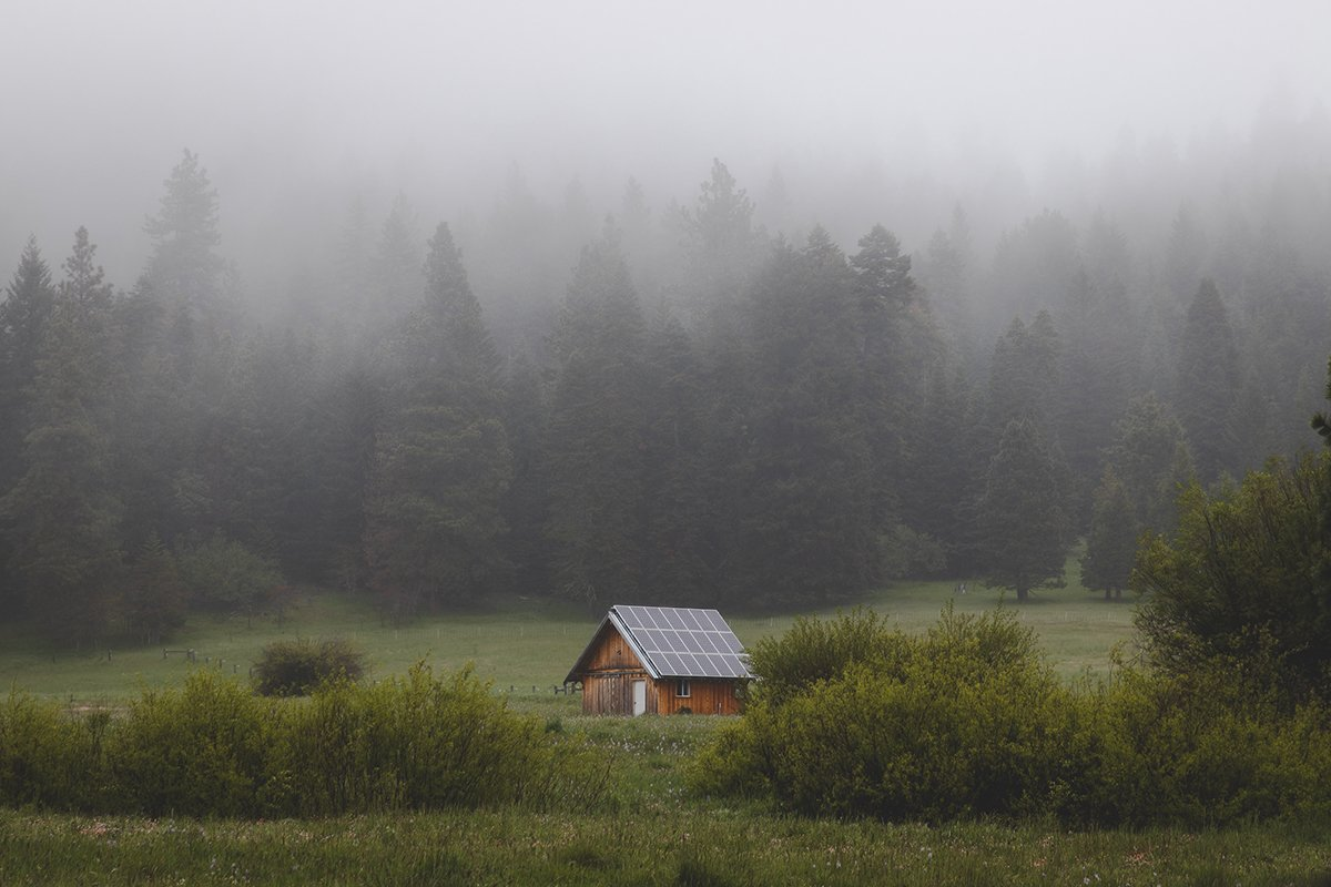 Small cabin off the grid with solar panels on roof