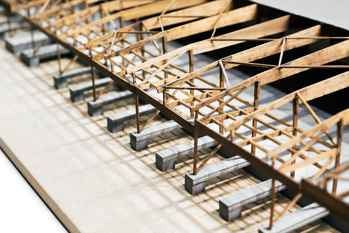Close up cropped image of architectural project model. Construction concept of building roof system. Copy space