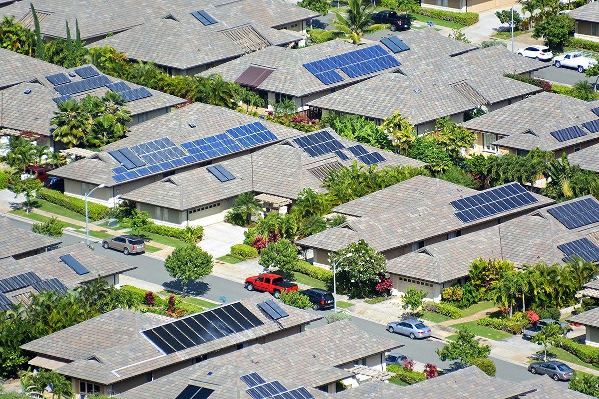 Neighborhood with solar panels on roofs