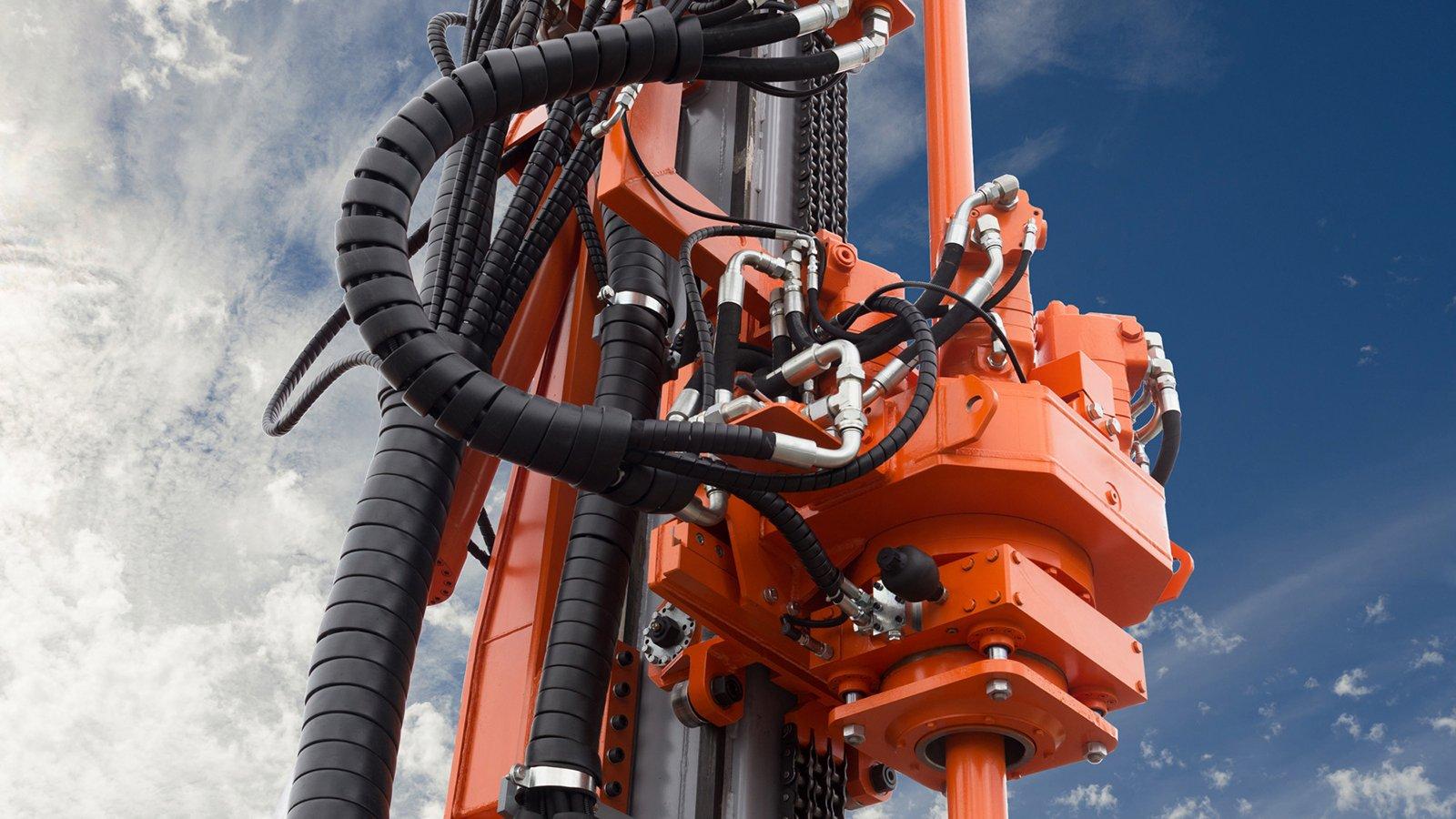 Elements of Hydraulic crawler oil drill machine on blue sky background